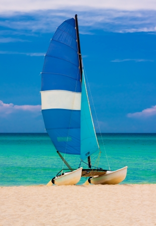 Sailing boat at a deserted beach in Cuba  vertical orientation  photo