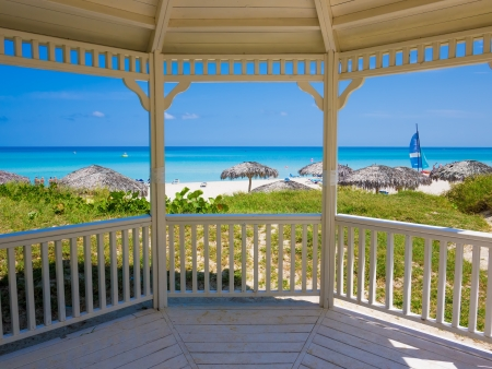 veranda: Tropical beach in Cuba seen from the windows of a nearby wooden house