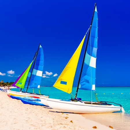 antilles: Colorful sailing  boats on a tropical beach in Cuba
