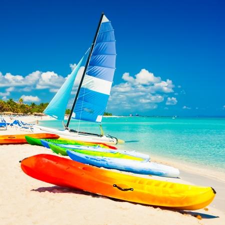 varadero: Colorful kayaks and sailing boats for rent at the beautiful beach of Varadero in Cuba