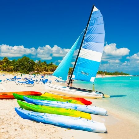 Colorful kayaks and sailing boats for rent at the beautiful beach of Varadero in Cuba photo