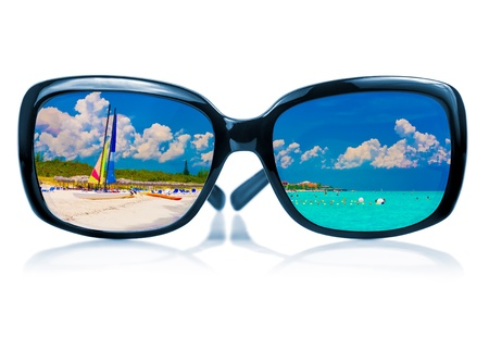 fashionable sunglasses: Trendy sunglasses with  a reflection of a tropical beach and sailing boats  isolated on white