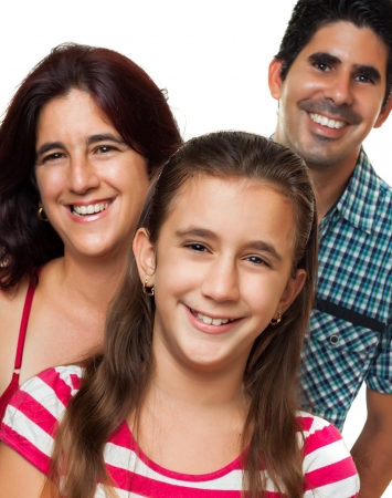 latin family: Portrait of a happy hispanic family consisting of father,mother and daughter isolated on a white background