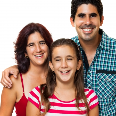 Portrait of a happy hispanic family consisting of father,mother and daughter isolated on a white background photo