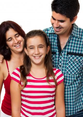 papa y mama: Retrato de un feliz padre hispano y madre mirando a su hija con una sonrisa aislados en blanco Foto de archivo