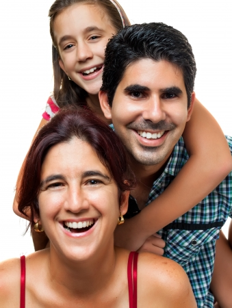 Happy hispanic family consisting of father,mother and daughter having fun together photo