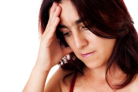 Close-up portrait of a stressed hispanic woman suffering depression or a strong headache isolated on white photo