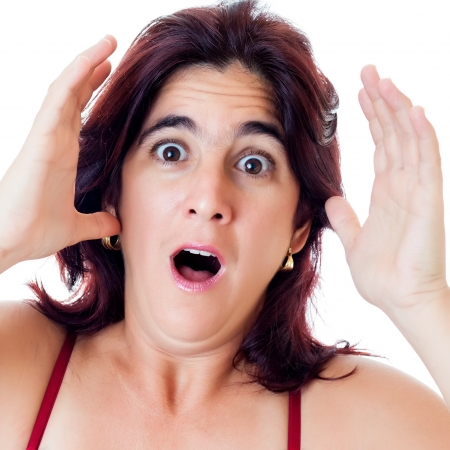Excited hispanic woman yelling with a surprise or fear expression isolated on white photo
