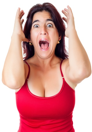 stunned: Excited hispanic woman yelling with a surprise or fear expression isolated on white Stock Photo