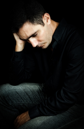 mental health problems: Dramatic portrait of a worried and depressed man isolated on black Stock Photo