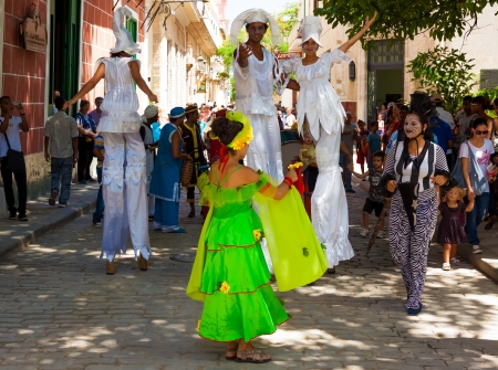 HAVANA-JULY 11:Musicians and stiltwalkers in Old Havana July 11,2012 in Havana.Artists performing in the streets help to give this area the atmosphere that attracts over 1 million tourists a year