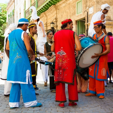 HAVANA-JULY 11:Music band in Old Havana July 11,2012 in Havana.Traditional artists playing in the old city help to give this area the colorful atmosphere that attracts over 1 million tourists a year