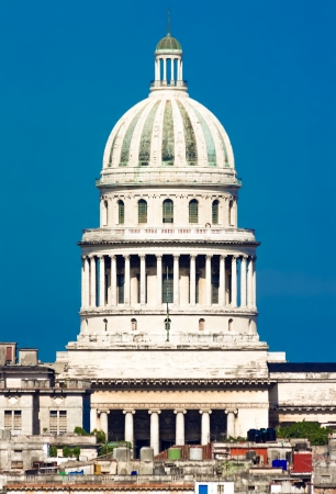 Iconic view of Havana including the dome of the Capitol against a clear blue sky