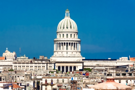 Famous view of Havana including the dome of the Capitol against a clear blue sky and parts of the old town Stock Photo - 14444715