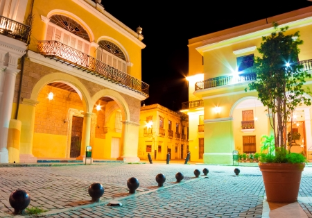 Beautiful spanish palaces illuminated at night on the famous  Plaza Vieja square in Old Havana photo