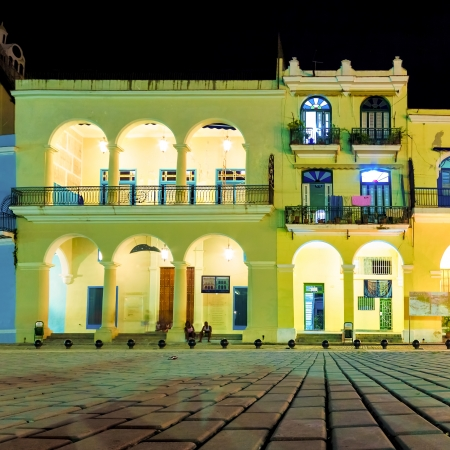 spanish house: Colonial houses illuminated at night on the famous  Plaza Vieja square in Old Havana Editorial
