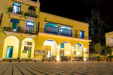Outdoors cafe illuminated at night on the beautiful Plaza Vieja Square in Old Havana