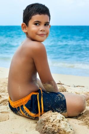 latin child: Hispanic boy on a beautiful tropical beach