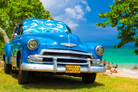 chevy: Classic car at a beach in Cuba