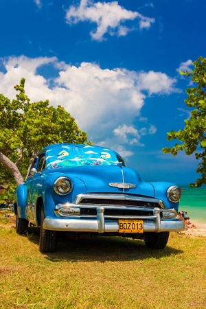 Classic Chevrolet at a beach in Cuba