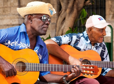 Musicians playing traditional music for tourists  in Havana