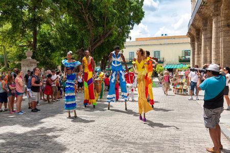 Street dancers on stilts in Old Havana