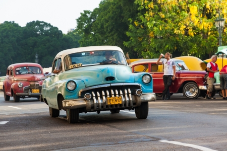 cab: Shabby old american car in Havana