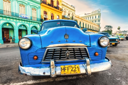 Shabby old Dodge in a colorful neighborhood in Havana