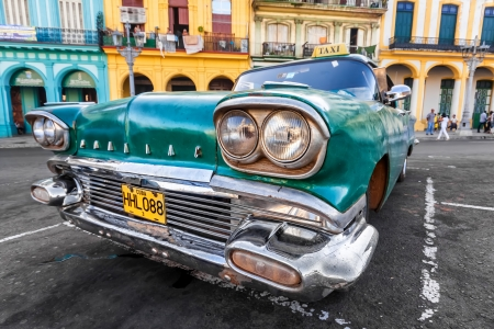 Vintage car in a colorful neighborhood in Havana Editorial