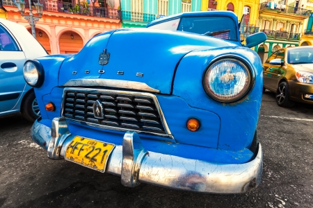 Shabby old Dodge in a colorful neighborhood in Havana Stock Photo - 14820551