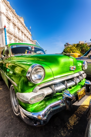chevy: Classic car parked near Central Park  in Havana