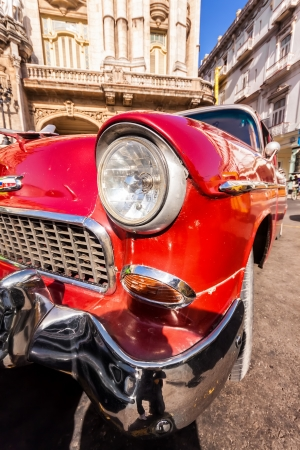 oldtimer: Red classic car near The Great Theater in Havana