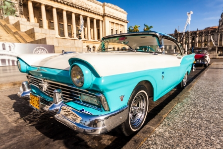 Vintage Ford Fairlane in front of the Capitol of Havana