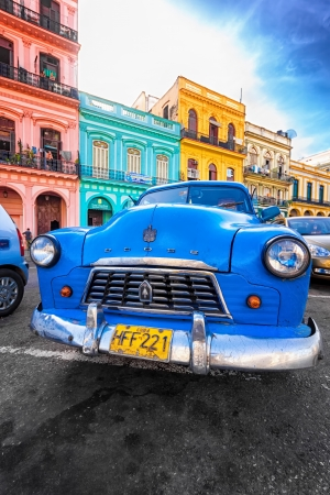 oldtimer: Old shabby Dodge in a colorful neighborhood in Havana