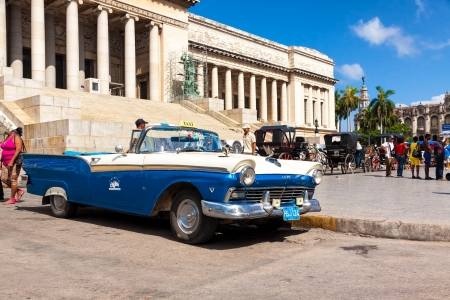 Vintage Ford parked in front of the Capitol in Havana