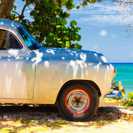 oldtimer: Vintage american car at the beach in Cuba