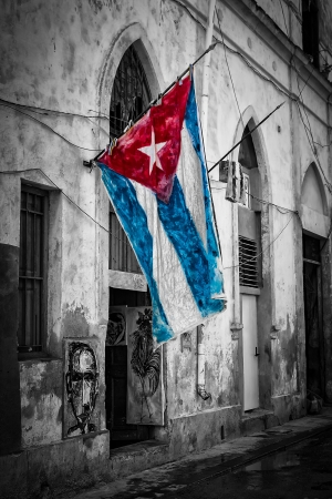 Colorful cuban flag in a shabby black and white street in Havana Stock Photo