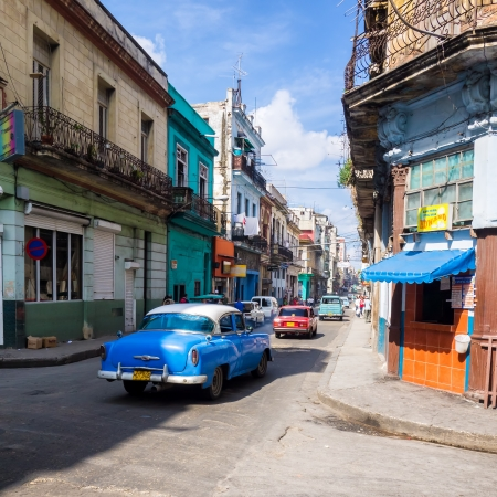 People and old cars in a central street in Havana Stock Photo - 15294824