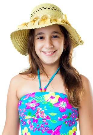 Beautiful hispanic girl wearing a colorful swimsuit and a straw hat isolated on white photo