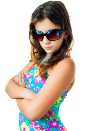 preteens beach: Trendy hispanic girl wearing a swimsuit and sunglasses isolated on white