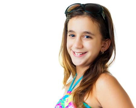 Cute hispanic girl wearing a swimsuit and dark sunglasses isolated on white photo