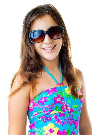 preteens beach: Cute hispanic girl wearing a swimsuit and dark sunglasses  smiling isolated on white