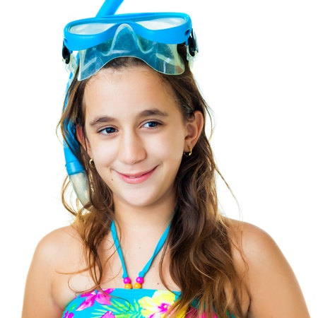 preteens beach: Portrait of a cute hispanic girl with a diving mask and snorkel isolated on white