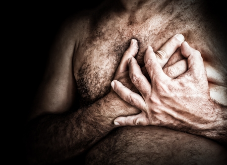Gritty image of a shirtless man suffering from chest pain and grabbing his chest Stock Photo - 15511014