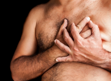 Shirtless man suffering a heart attack and grabbing his chest Stock Photo - 15511013