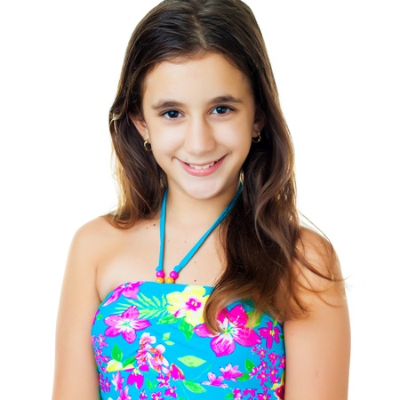 preteens beach: Portrait of a beautiful hispanic teen wearing a swimsuit isolated on white Stock Photo