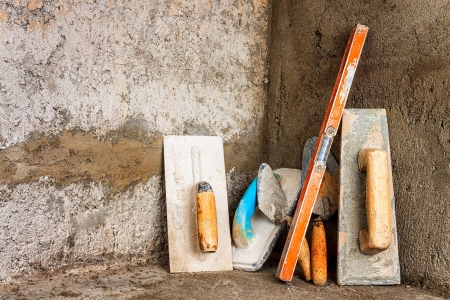 Trowels and spirit level on a rough concrete surface Stock Photo - 15436909