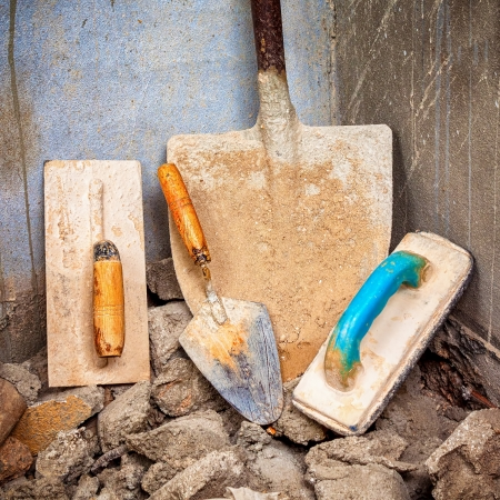 Dirty shovel and masonry tools on a construction site Stock Photo - 15436870