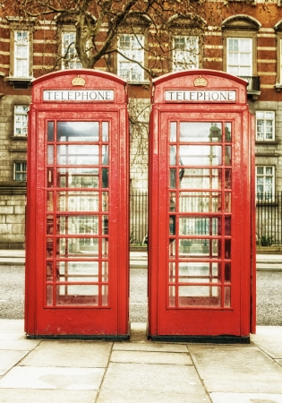 Antique red phone cabins, a worldwide known symbol of  London photo