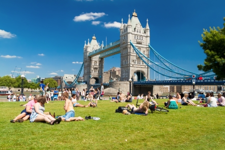 london tower bridge: Londoners and tourists near Tower Bridge  in London An iconic image of London,the area around the bridge is popular with Londoners and tourists looking to relax and enjoy the beauty of the city